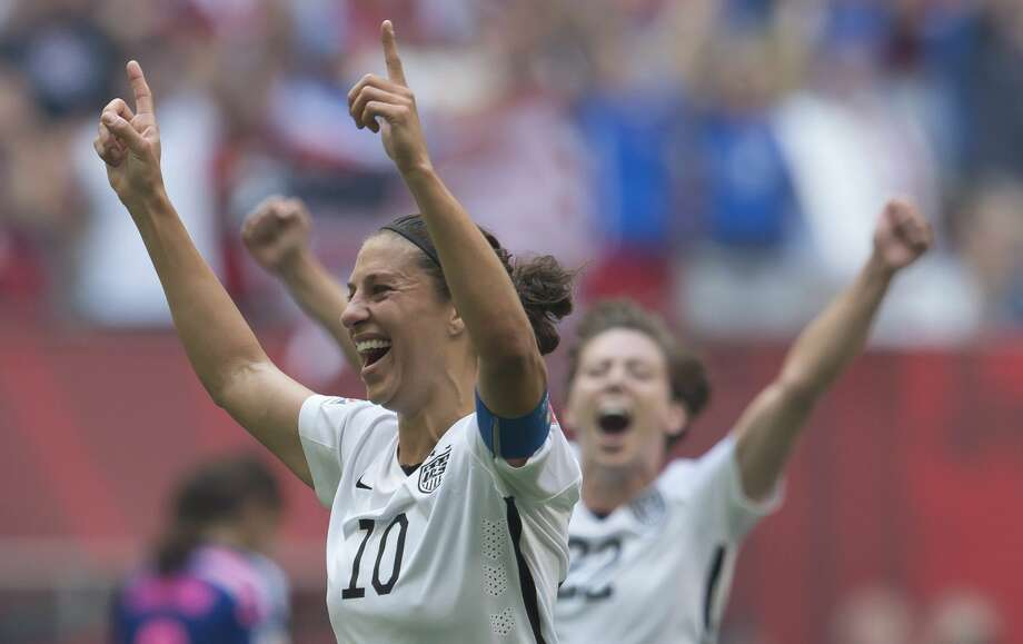 United States' Carli Lloyd, left, celebrates her goal with Meghan Klingenberg during the first half of the FIFA Women's World Cup soccer championship against Japan in Vancouver, British Columbia, Canada, Sunday, July 5, 2015. (Jonathan Hayward/The Canadian Press via AP) MANDATORY CREDIT