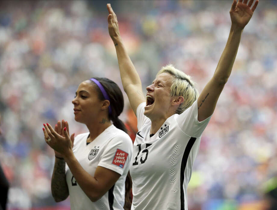 United States' Megan Rapinoe, right, celebrates with Sydney Leroux, left, after the U.S. beat Japan 5-2 in the FIFA Women's World Cup soccer championship in Vancouver, British Columbia, Canada, Sunday, July 5, 2015. (AP Photo/Elaine Thompson)