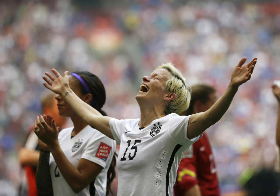 United States' Megan Rapinoe celebrates after the U.S. beat Japan 5-2 in the FIFA Women's World Cup soccer championship in Vancouver, British Columbia, Canada, Sunday, July 5, 2015. (AP Photo/Elaine Thompson)