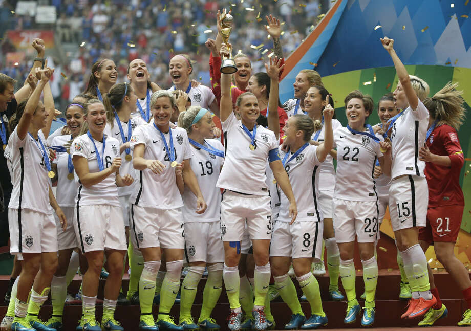 The United States Women's National Team celebrates with the trophy after they beat Japan 5-2 in the FIFA Women's World Cup soccer championship in Vancouver, British Columbia, Canada, Sunday, July 5, 2015. (AP Photo/Elaine Thompson)