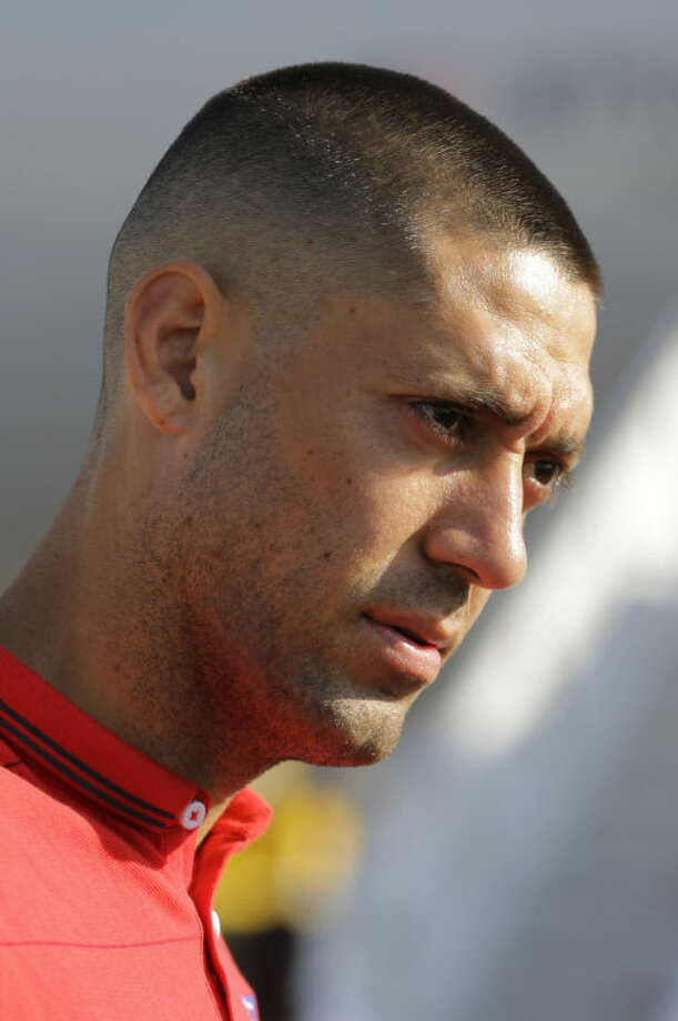 United States' national soccer team player Clint Dempsey arrives at the Sao Paulo International airport in Brazil, Monday, June 9, 2014. The U.S. team arrived in Sao Paulo to continue their preparations for the upcoming Brazil 2014 World Cup, which starts on June 12. (AP Photo/Nelson Antoine)
