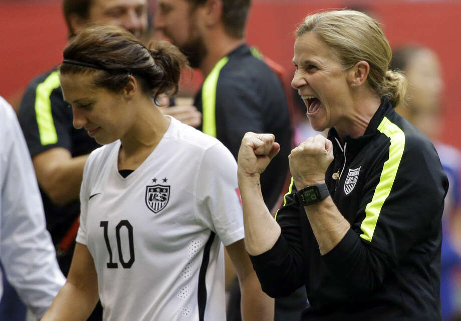 United States head coach Jill Ellis, right, celebrates next to midfielder Carli Lloyd (10), after the U.S. beat Japan 5-2 in the FIFA Women's World Cup soccer championship against Japan in Vancouver, British Columbia, Canada, Sunday, July 5, 2015. Lloyd scored three goals in the match. (AP Photo/Elaine Thompson)