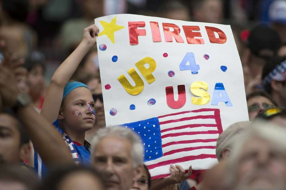 A young fan of the United States holds a sign in the stands before the FIFA Women's World Cup soccer championship between the U.S. and Japan in Vancouver, British Columbia, Canada, on Sunday, July 5, 2015. (Jonathan Hayward/The Canadian Press via AP) MANDATORY CREDIT