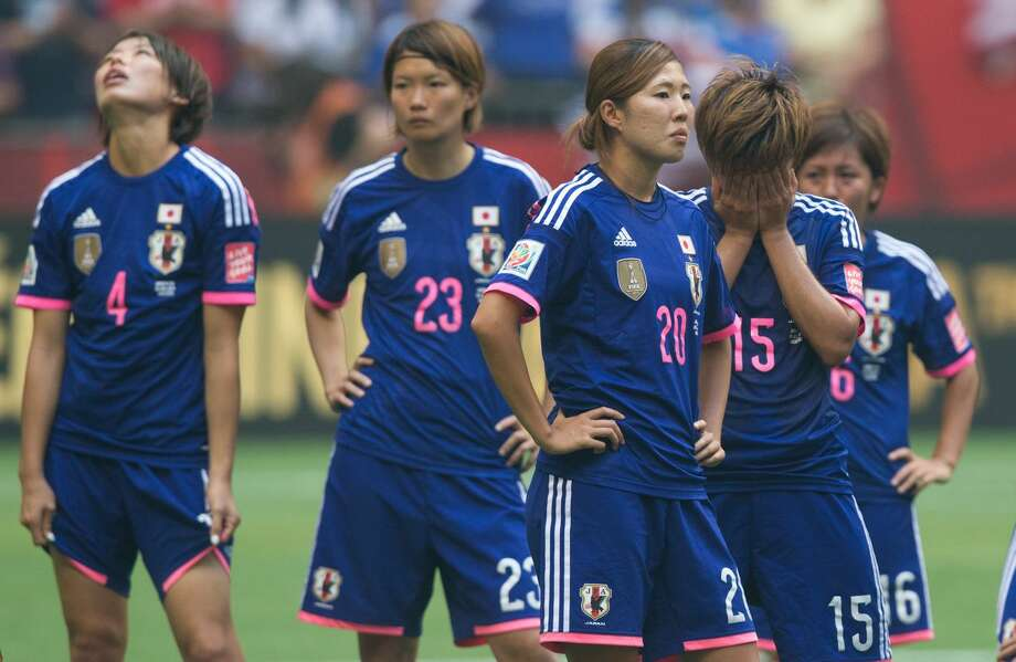 Japan's Saki Kumagai, from left to right, Kana Kitahara, Yuri Kawamura and Yuika Sugasawa react after losing to the United States during the FIFA Women's World Cup final in Vancouver, British Columbia on Sunday July 5, 2015. (Darryl Dyck/The Canadian Press via AP)
