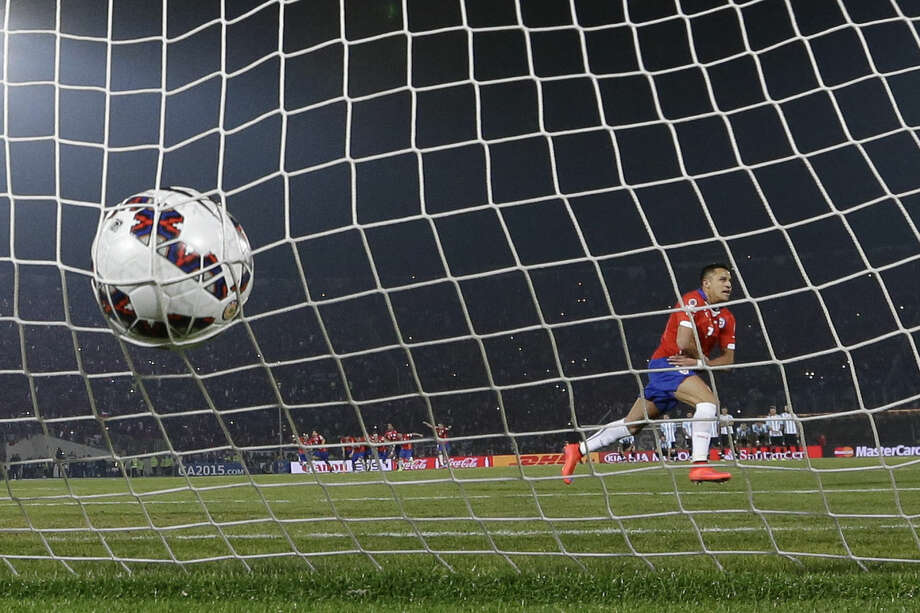 In this July 4, 2015 photo, Chile's Alexis Sanchez celebrates scoring the winning penalty kick against Argentina during the Copa America final soccer match in Santiago, Chile, Saturday, July 4, 2015. Chile became Copa America champions for the first time. (AP Photo/Ricardo Mazalan)
