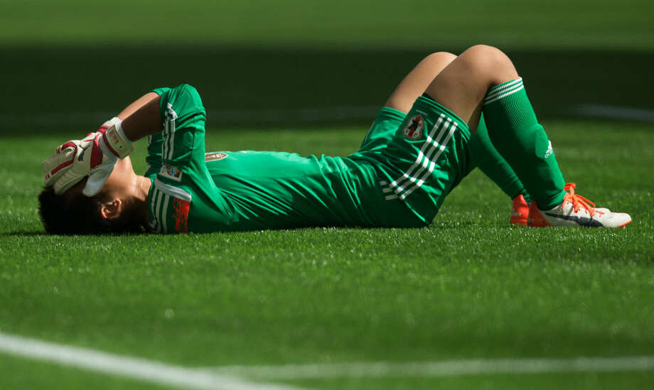 Japan goalkeeper Ayumi Kaihori reacts after allowing a third goal to United States' Carli Lloyd, the team's fourth, during the first half of the FIFA Women's World Cup soccer championship in Vancouver, British Columbia, Canada, on Sunday, July 5, 2015. (Darryl Dyck/The Canadian Press via AP) MANDATORY CREDIT