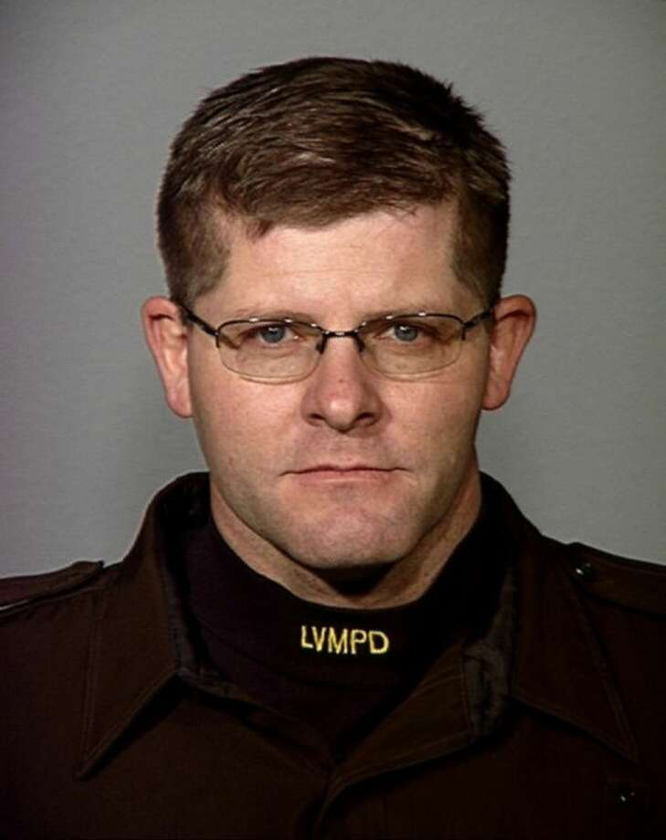 This undated photo provided by the Las Vegas Metropolitan Police Department shows Officer Alyn Beck. Two suspects shot and killed two police officers in an ambush at a Las Vegas restaurant Sunday, June 8, 2014, before fatally shooting a third person and killing themselves inside a nearby Wal-Mart, authorities said. (AP Photo/Las Vegas Metropolitan Police Department)