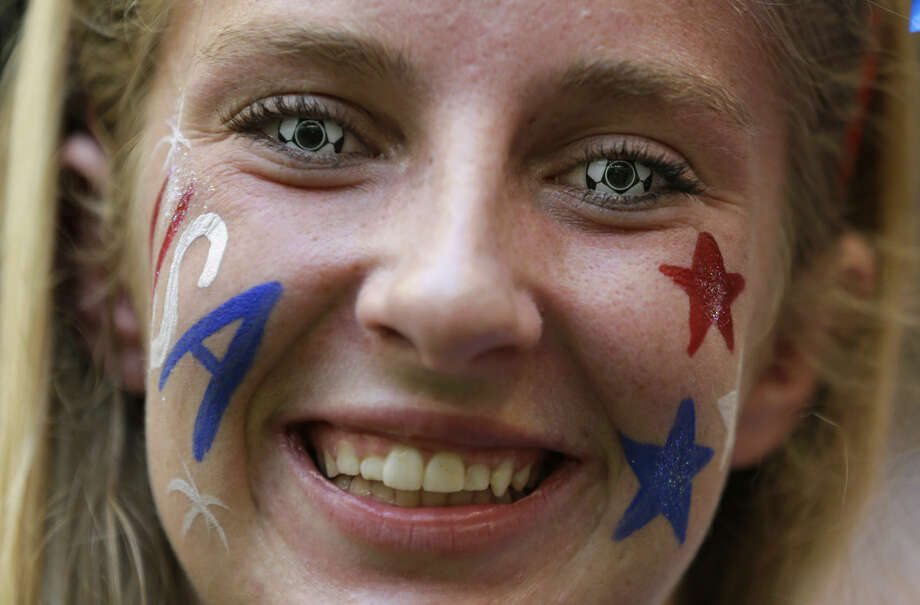 Krista McMahan, of St. Louis, wears soccer ball contact lenses as she cheers before the FIFA Women's World Cup soccer championship final between the United States and Japan in Vancouver, British Columbia, Canada, Sunday, July 5, 2015. (AP Photo/Elaine Thompson)