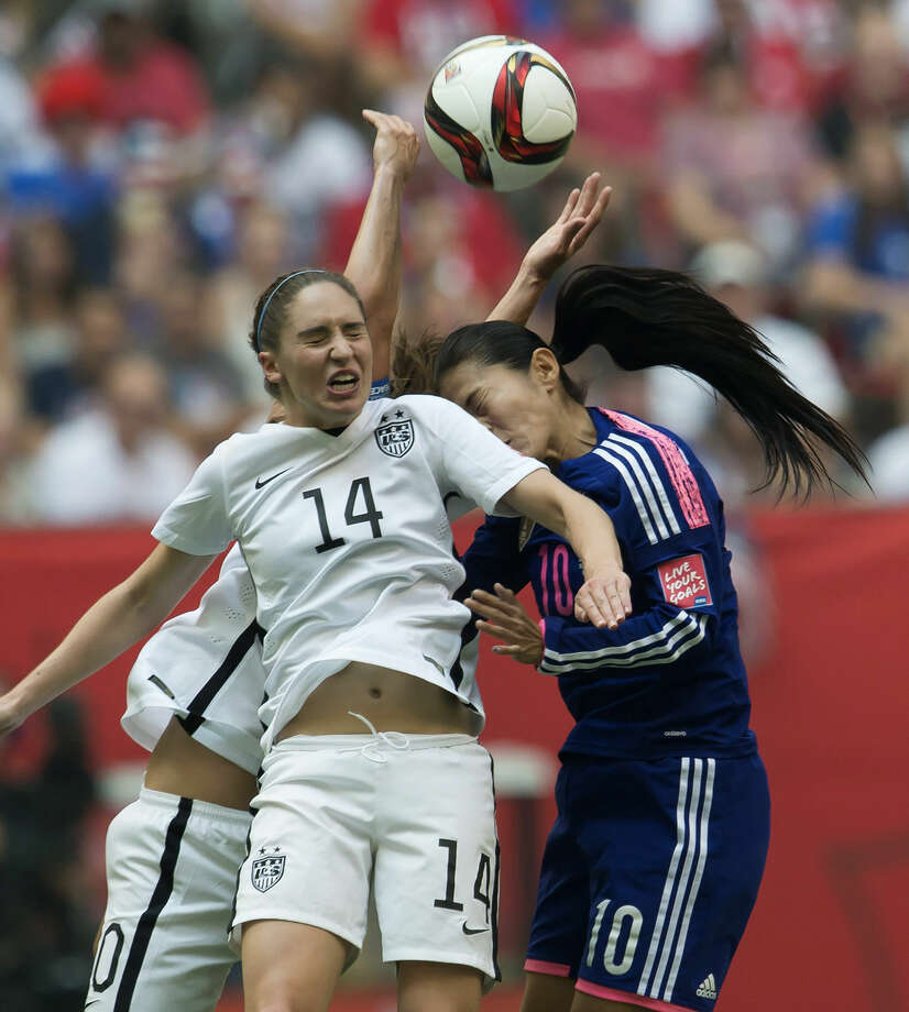 United States' Morgan Brian, right, fights for control of the ball with Japan's Homare Sawa during the first half of the final of the FIFA Women's World Cup soccer championship in Vancouver, British Columbia, Canada, Sunday, July 5, 2015. (Jonathtan Hayward/The Canadian Press via AP) MANDATORY CREDIT