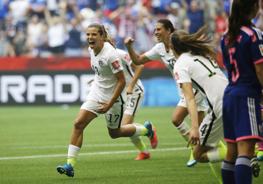 United States' Tobin Heath, left, celebrates after she scored a goal against Japan during the second half of the FIFA Women's World Cup soccer championship in Vancouver, British Columbia, Canada, Sunday, July 5, 2015. (AP Photo/Elaine Thompson)