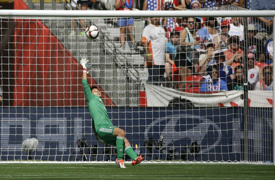 Japan's goalkeeper Ayumi Kaihori tries but can't save a goal scored by United States' Carli Lloyd during the first half of the FIFA Women's World Cup soccer championship in Vancouver, British Columbia, Canada, Sunday, July 5, 2015. (AP Photo/Elaine Thompson)