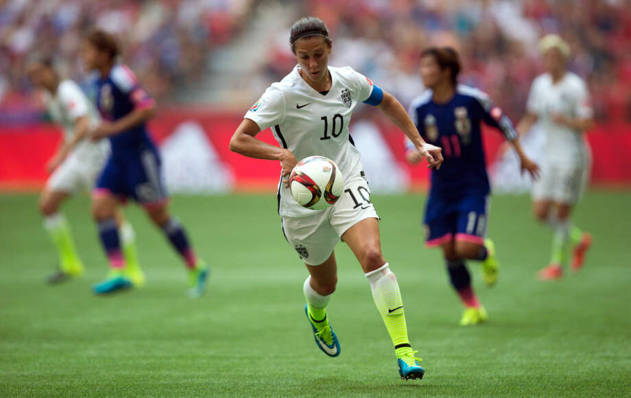 United States' Carli Lloyd (10) chases down the ball during the first half of the FIFA Women's World Cup soccer championship against Japan in Vancouver, British Columbia, Canada, on Sunday, July 5, 2015. (Darryl Dyck/The Canadian Press via AP) MANDATORY CREDIT