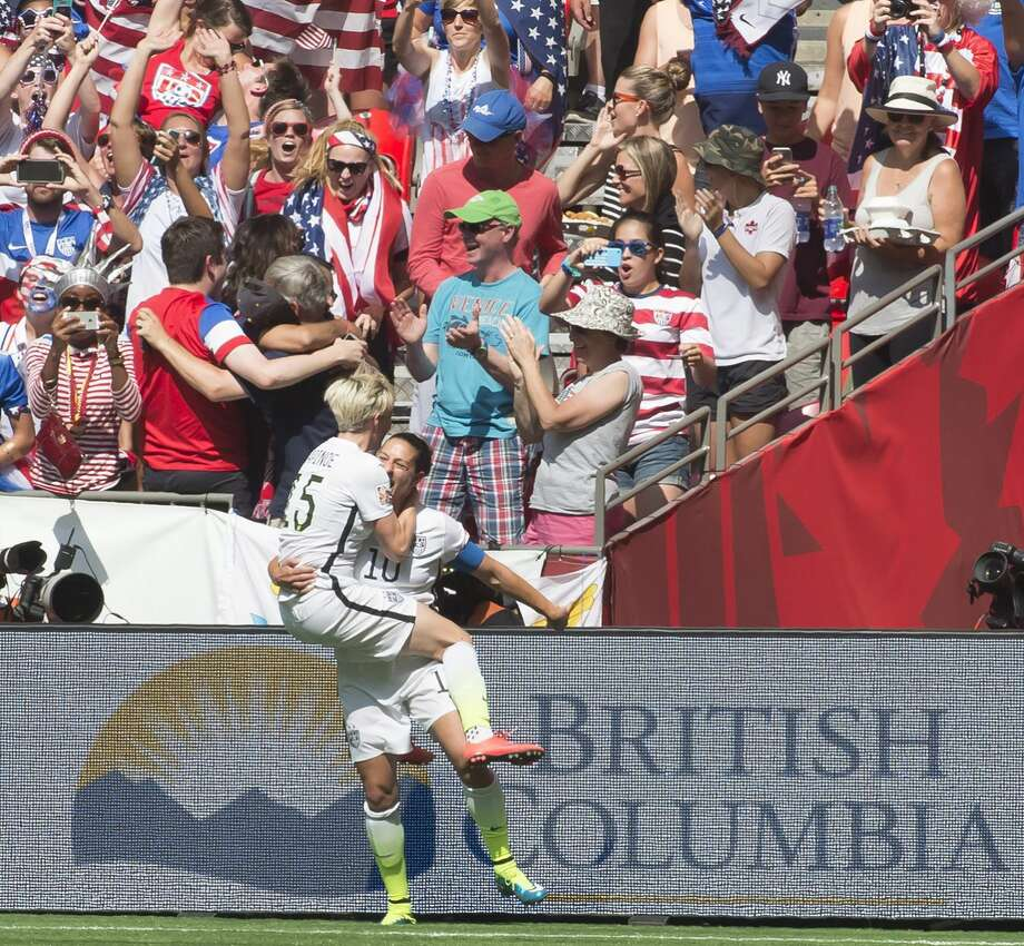 United States' Carli Lloyd, right, celebrates her goal with Megan Rapinoe during the first half of the FIFA Women's World Cup soccer championship in Vancouver, British Columbia, Canada, Sunday, July 5, 2015. (Jonathan Hayward/The Canadian Press via AP) MANDATORY CREDIT