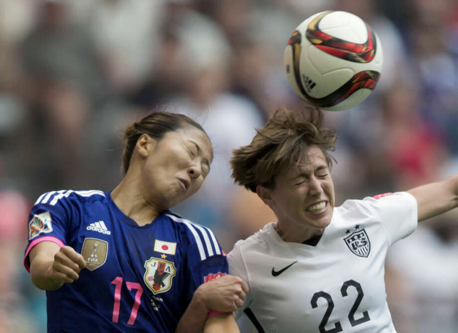 Japan's Yuki Ogimi, left, and United States' Meghan Klingenberg vie for the ball during the second half of the FIFA Women's World Cup soccer championship in Vancouver, British Columbia, Canada, on Sunday, July 5, 2015. The United States won 5-2. (Darryl Dyck/The Canadian Press via AP) MANDATORY CREDIT