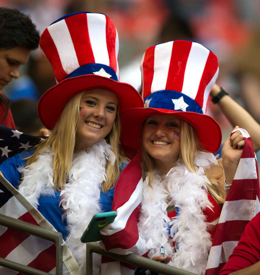 Fans of the United States wait for the U.S. and Japan to play in the FIFA Women's World Cup soccer championship in Vancouver, British Columbia, Canada, on Sunday, July 5, 2015. (Darryl Dyck/The Canadian Press via AP) MANDATORY CREDIT