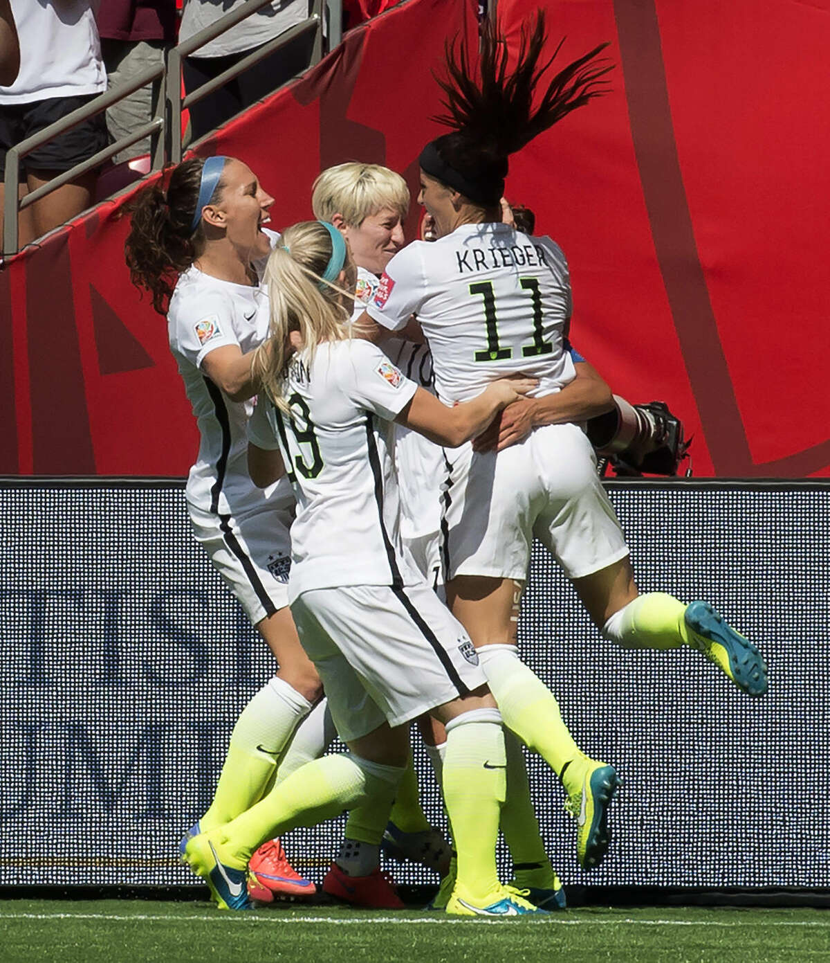 The United States team celebrates Carli Lloyd's goal during the first half of the FIFA World Cup soccer championship against Japan in Vancouver, British Columbia, Canada, Sunday, July 5, 2015. (Jonathan Hayward/The Canadian Press via AP) MANDATORY CREDIT