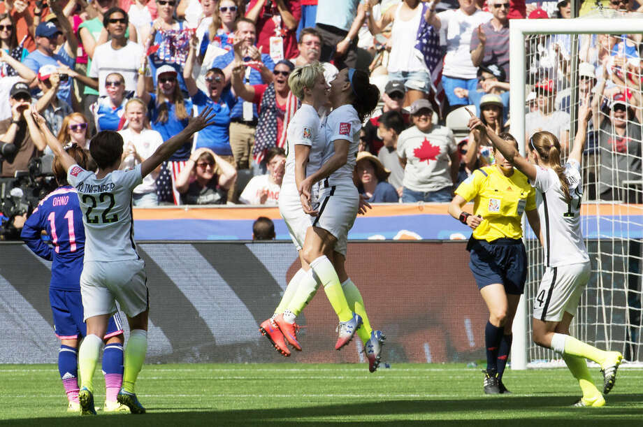 United States' Lauren Holiday, center right, Megan Rapinoe, center left, Meghan Klingenberg (22) and Morgan Brian (14) celebrate Holiday's goal against Japan during first half action in the FIFA Women's World Cup soccer soccer championship in Vancouver, British Columbia, Canada, Sunday, July 5, 2015. (Jonathan Hayward/The Canadian Press via AP) MANDATORY CREDIT