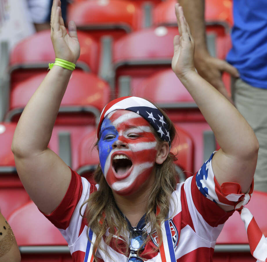 A United States fan with a painted face cheers before the start of the FIFA Women's World Cup soccer championship between the U.S. and Japan in Vancouver, British Columbia, Canada, Sunday, July 5, 2015. (AP Photo/Elaine Thompson)