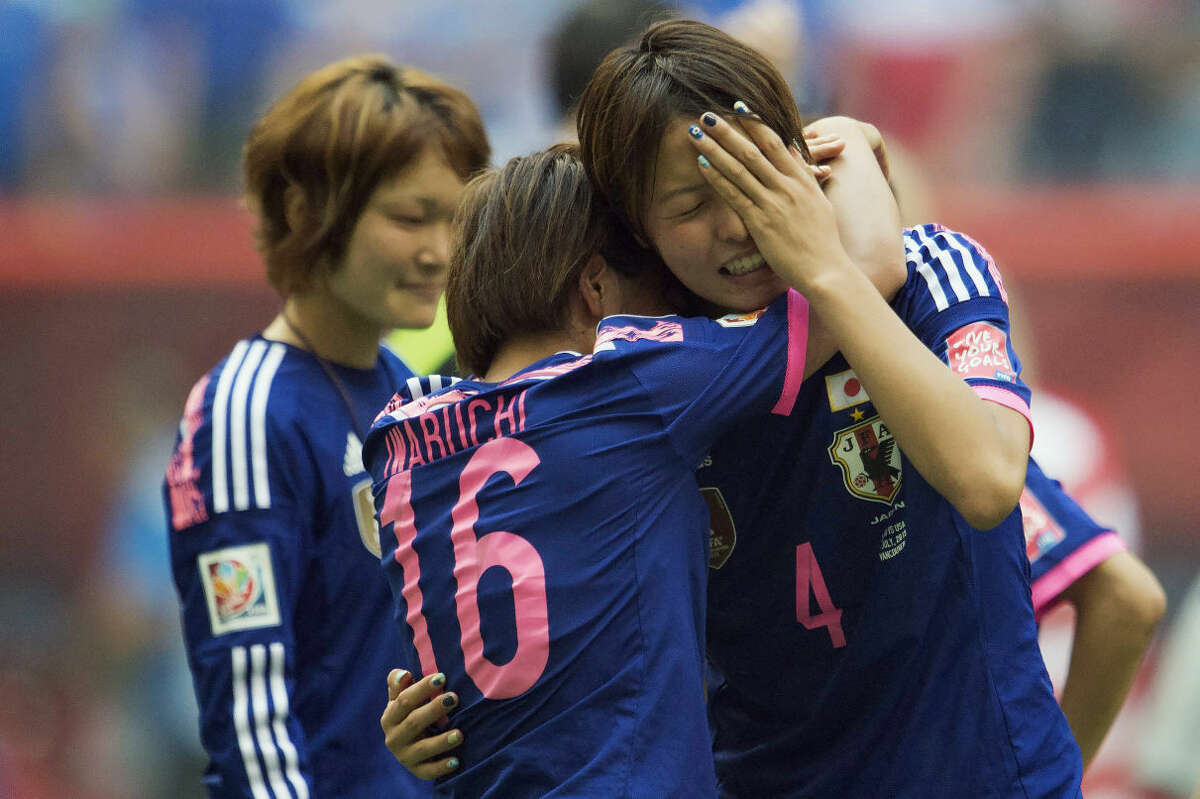 Japan's Mana Iwabuchi (16) and Saki Kumagai (4) console each other after the FIFA Women's World Cup soccer championship final against Japan in Vancouver, British Columbia, Canada, Sunday, July 5, 2015. The United States won 5-2. (Jonathtan Hayward/The Canadian Press via AP) MANDATORY CREDIT