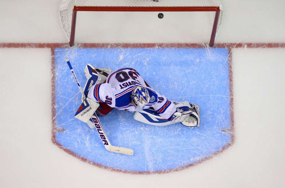New York Rangers goalie Henrik Lundqvist, of Sweden, is scored on by Los Angeles Kings right wing Dustin Brown during the second overtime period in Game 2 of the NHL hockey Stanley Cup Finals, Saturday, June 7, 2014, in Los Angeles. The Kings won 5-4. (AP Photo/Mark J. Terrill)