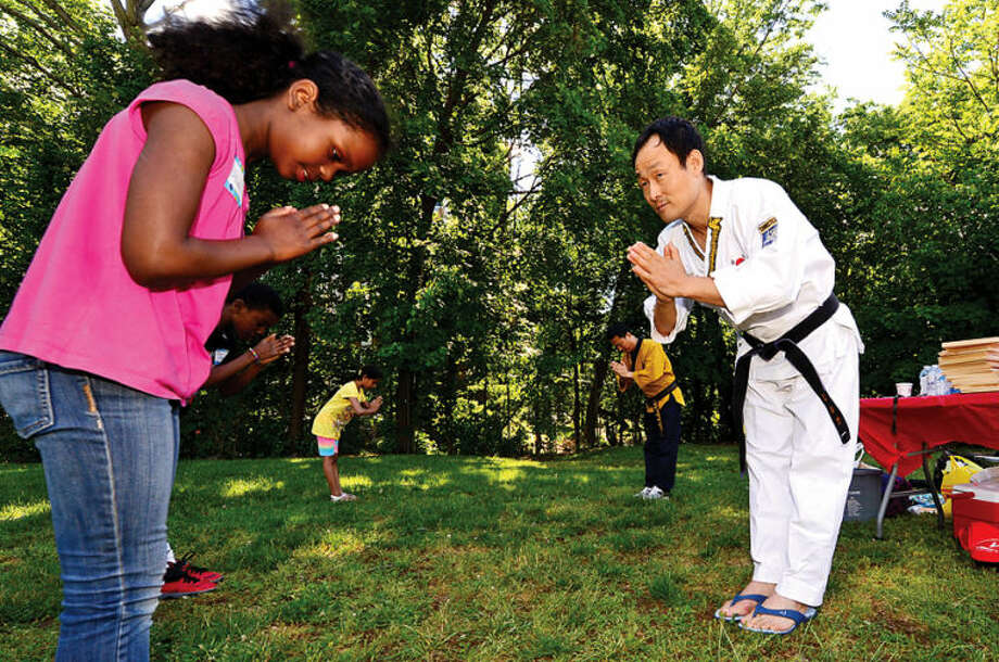 Hart Magnet School fourth-graders, including Akua Biggs, participate in a day of outdoor learning Friday with Grandmaster Yong Bum Kim of YB World Taekwondo Academy.