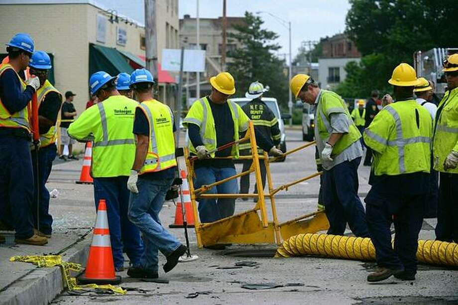Connecticut Light & Power crews work the scene of an apparent electrical explosion Tuesday morning.