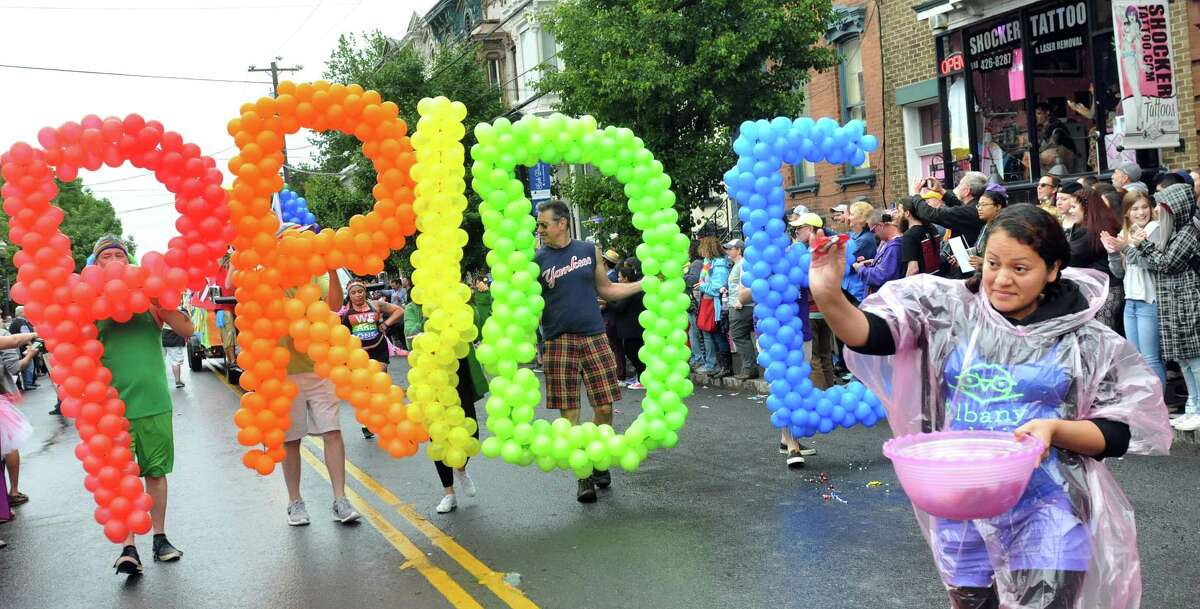 Marchers show their colors in the Capital PRIDE Parade on Saturday, June 11, 2016, in Albany, N.Y. The annual parade, festival and rally celebrates the Lesbian, Gay, Bisexual, Transgender and Queer community with entertainment and family-friendly activities. (Cindy Schultz / Times Union)
