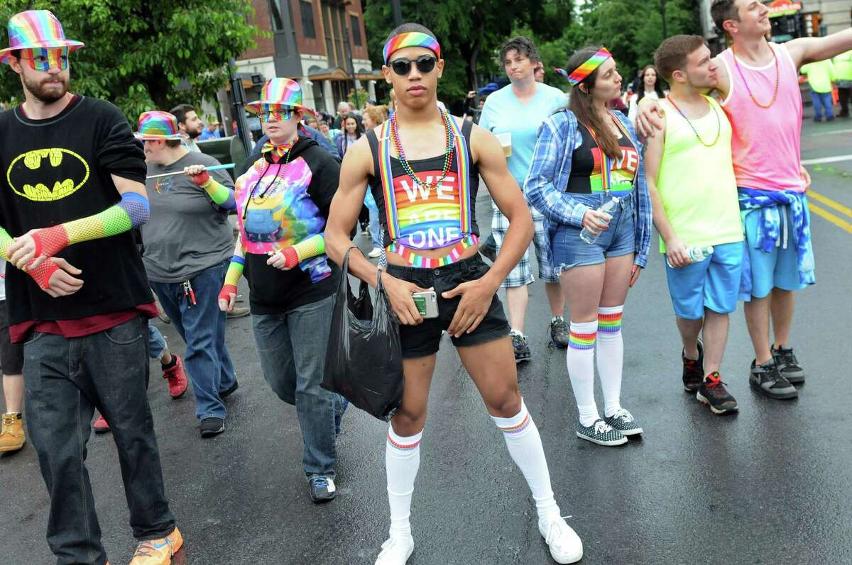 Jacob Tate, 18, of Latham, center, strikes a pose during the Capital PRIDE Parade on Saturday, June 11, 2016, in Albany, N.Y. The annual parade, festival and rally celebrates the Lesbian, Gay, Bisexual, Transgender and Queer community with entertainment and family-friendly activities. (Cindy Schultz / Times Union)