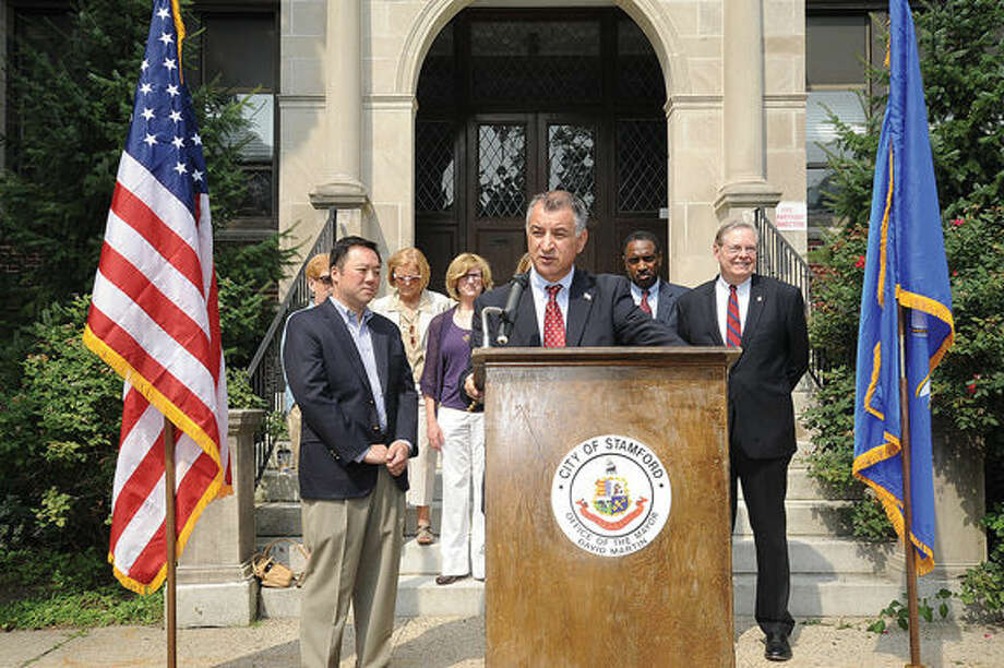 State Sen. Carlo Leone, along with state Rep. William Tong, Mayor David Martin and other local officials, announce an initiative to expand Rogers Inter-District Magnet School on Monday in front of the former Sacred Heart Academy in Stamford.