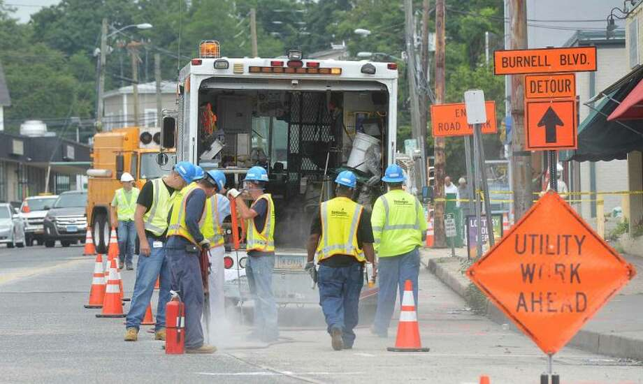 Hour Photo/Alex von Kleydorff Yankee Gas opens up a section of Main St to investigate an explosion Tuesday morning