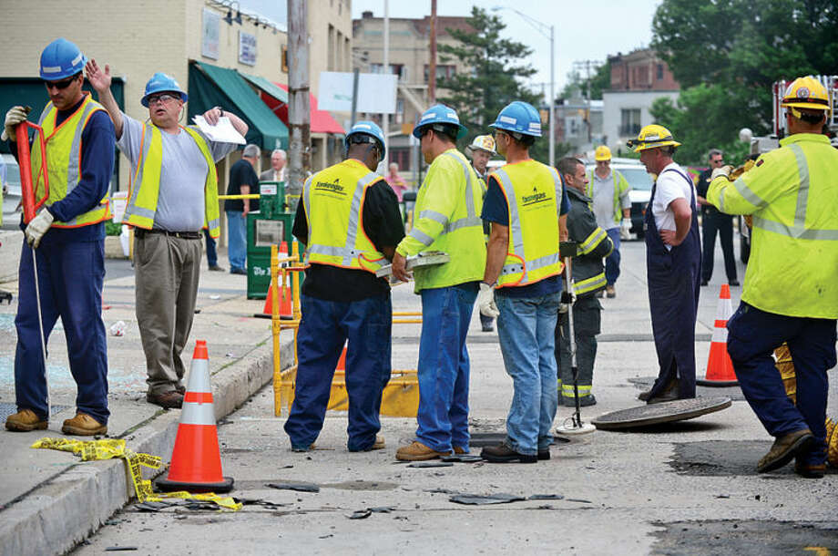 Hour photo / Erik Trautmann An underground explosion rocked Main St Tuesday morning blowing out windows Muro's New York Bakery and knocked out power to the area.