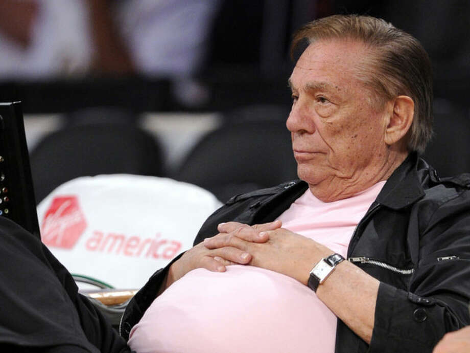 """FILE - In this Oct. 17, 2010 file photo, Los Angeles Clippers team owner Donald Sterling watches his team play in Los Angeles. The NBA is investigating a report of an audio recording in which a man purported to be Sterling makes racist remarks while speaking to his girlfriend. NBA spokesman Mike Bass said in a statement Saturday, APril 26, 2014, that the league is in the process of authenticating the validity of the recording posted on TMZ's website. Bass called the comments """"disturbing and offensive."""" (AP Photo/Mark J. Terrill, File)"""