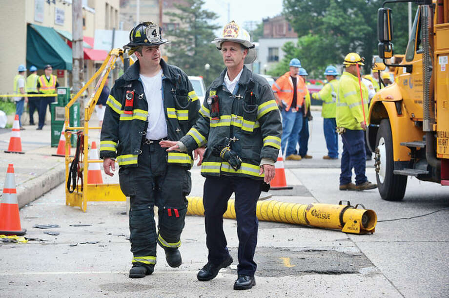 Hour photo /Erik Trautann An underground explosion rocked Main St Tuesday morning blowing out windows at Muro's New York Bakery and knocking out power to the area.
