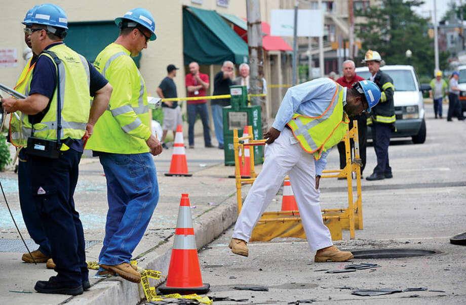 Hour photo / Erik Trautmann An underground explosion rocked Main St Tuesday morning blowing out windows at Muro's New York Bakery and knocking out power to the area.