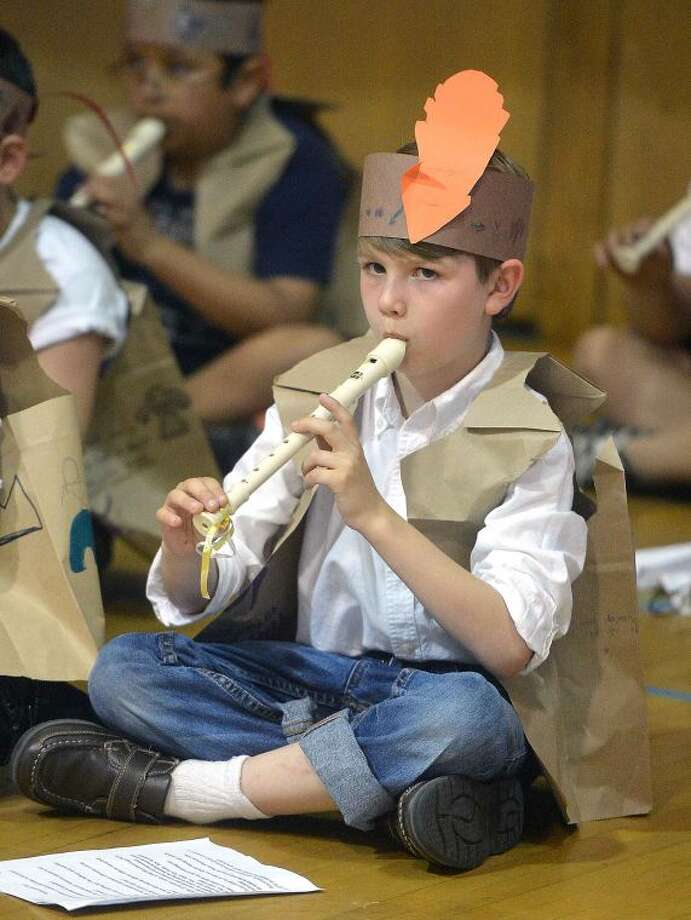 Hour Photo/Alex von Kleydorff Silvermine School 3rd grader Patrick Davidson plays along with a Native American chant during the school's Multicultural Day
