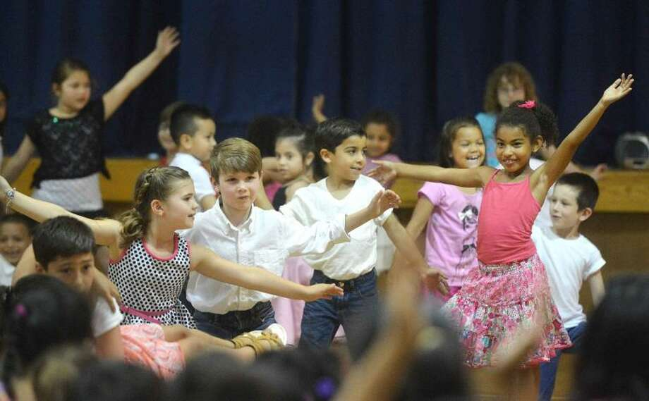 Hour Photo/Alex von Kleydorff Silvermine School students dance to the 50's music of Rock Around The Clock during the schools Multicultural Day