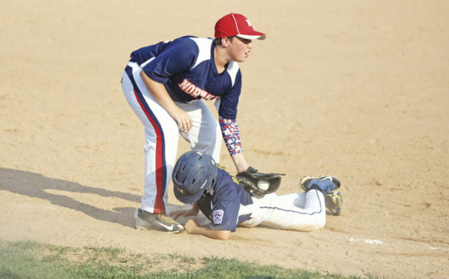 Hour photo/Danielle CallowayNorwalk's Jake Pomponi tags out a Weston runner trying to slide into third base. Norwalk beat Weston 10-4.