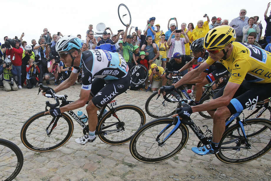 Stage winner and new overall leader Germany's Tony Martin is followed by Britain's Christopher Froome, right, during the fourth stage of the Tour de France cycling race over 223.5 kilometers (138.9 miles) with start in Seraing, Belgium, and finish in Cambrai, France, Tuesday, July 7, 2015. (AP Photo/Christophe Ena)
