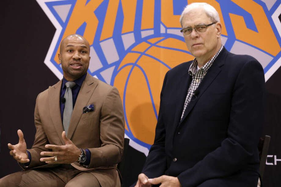 While New York Knicks president Phil Jackson, right, listens, Derek Fisher speaks during a news conference in Tarrytown, N.Y., Tuesday, June 10, 2014. The New York Knicks hired Fisher as their new coach on Tuesday, with Jackson turning to one of his trustiest former players. (AP Photo/Seth Wenig)
