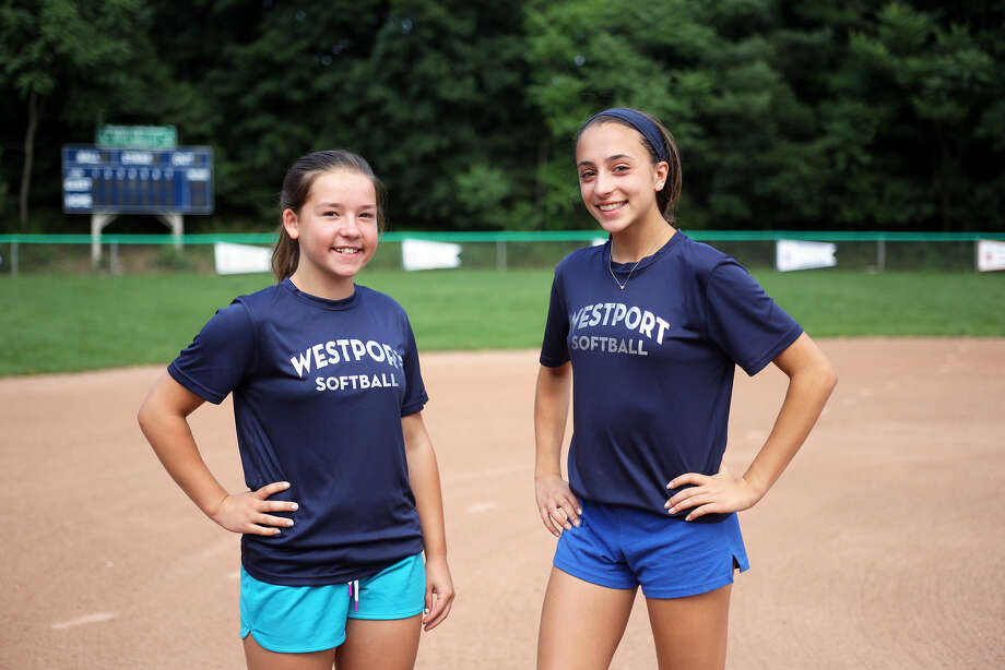 Westport Little League softball catcher Maisie Dembski, left, and pitcher Sophia Alfero form a dominant duo that has led Westport to a District Championship. Up next for Westport is the divisional tournament.(Hour photo/Danielle Calloway)