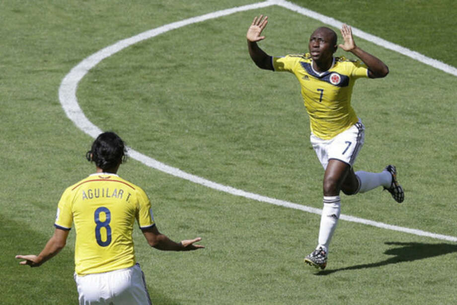 Colombia's Pablo Armero celebrates after scoring during the group C World Cup soccer match between Colombia and Greece at the Mineirao Stadium in Belo Horizonte, Brazil, Saturday, June 14, 2014. (AP Photo/Andrew Medichini)