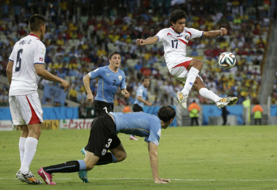 Costa Rica's Yeltsin Tejeda clears the ball during the group D World Cup soccer match between Uruguay and Costa Rica at the Arena Castelao in Fortaleza, Brazil, Saturday, June 14, 2014. (AP Photo/Christophe Ena)