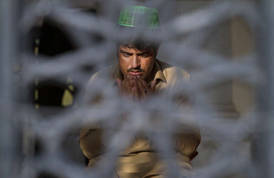 A Pakistani prays at a mosque during the fasting month of Ramadan in Islamabad, Pakistan, Tuesday, July, 7, 2015. Muslims across the world are observing the holy fasting month of Ramadan, where they refrain from eating, drinking and smoking from dawn to dusk. (AP Photo/Anjum Naveed)