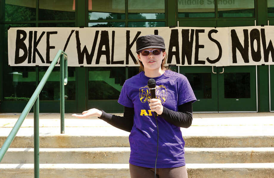 Hour photo / Erik Trautmann AITE freshman Cynthia Lup speaks at a rally Saturday at Rippowam Middle School to advocate for more bike lanes on High Ridge Road, increased safety for runners, cyclists, drivers and improved connectivity to the rest of the city.