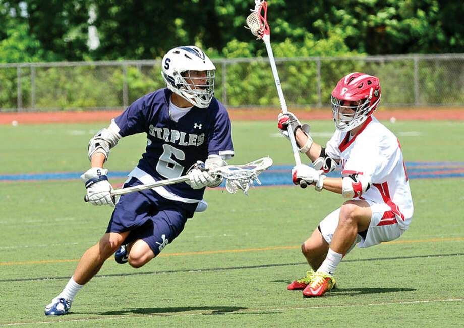 Hour photo / Erik Trautmann Staples #6 Tucker Bobrow looks from room to pass as they play Greenwich in the boys Class L lacrosse championship game Saturday at Brien MacMahon High School..