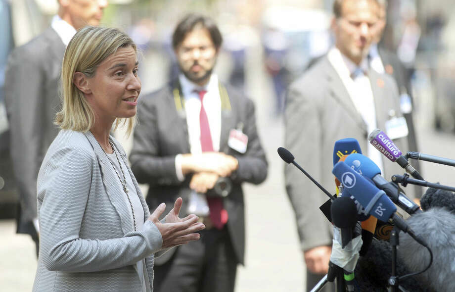 "European Union High Representative Federica Mogherini talks to media in front of Palais Coburg where closed-door nuclear talks with Iran take place in Vienna, Austria, Tuesday, July 7, 2015. Mogherini said that negotiations will continue for the next couple of days despite hitting some ""tense"" moments. (AP Photo/Ronald Zak)"