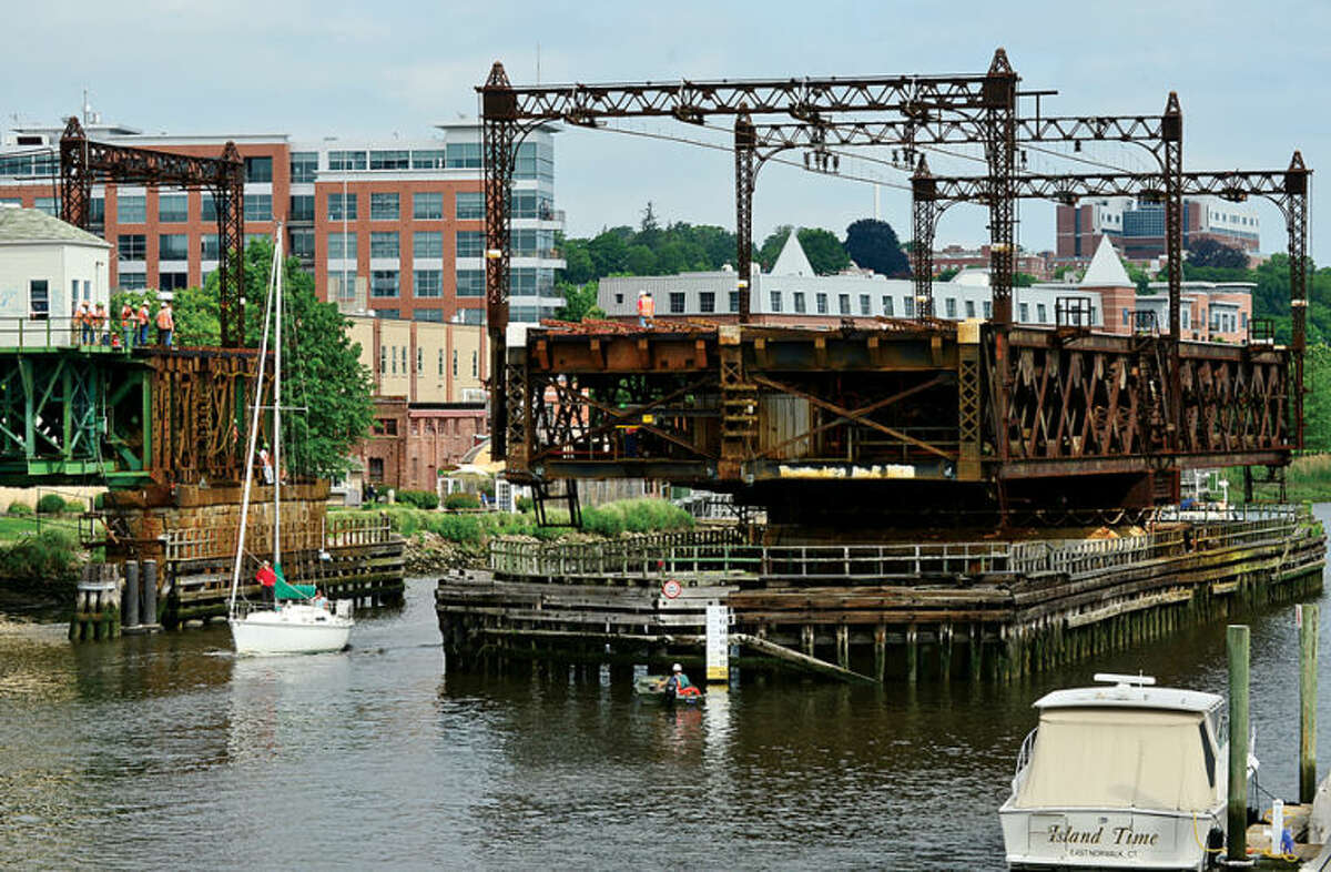 Hour photo / Erik Trautmann The troubled South Norwalk New Haven line bridge was opened briefly Saturday by Metro-North to allow boaters to move their boats out of the Norwalk River. The future operation of the draw bridge is uncertain.