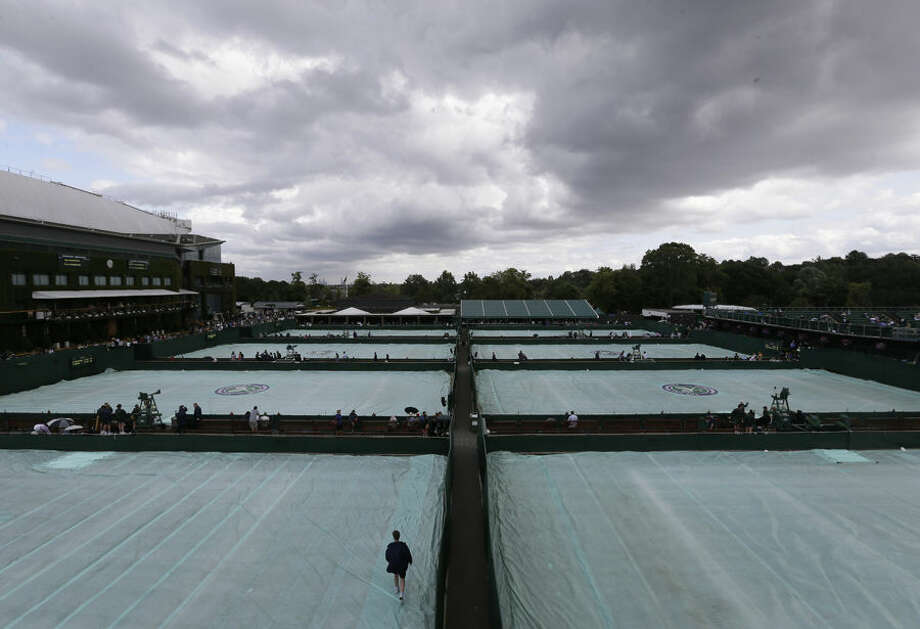 Rain clouds gather over the outside courts, at the All England Lawn Tennis Championships in Wimbledon, London, Tuesday July 7, 2015. (AP Photo/Tim Ireland)