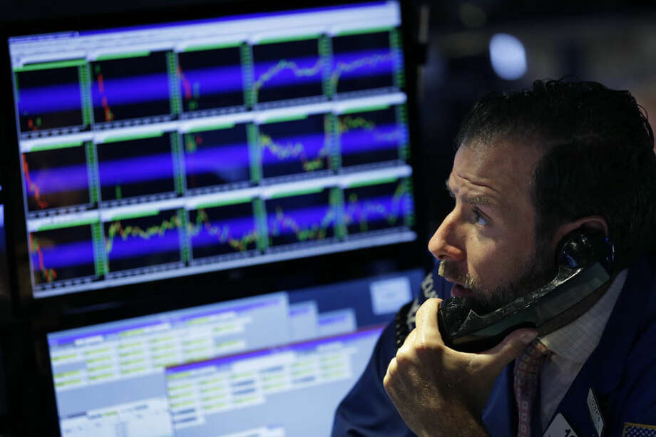 Specialist William Bott works on the floor of the New York Stock Exchange, Tuesday, July 7, 2015, in New York. Global stocks mostly fell on Tuesday as Greece's spiraling crisis kept investors on edge and as Chinese markets dropped despite government intervention. (AP Photo/Seth Wenig)