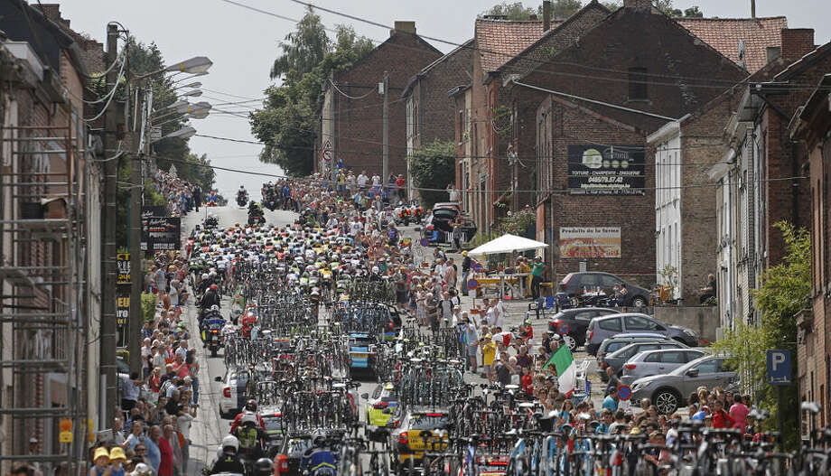 The pack climbs a hill during the fourth stage of the Tour de France cycling race over 223.5 kilometers (138.9 miles) with start in Seraing, Belgium, and finish in Cambrai, France, Tuesday, July 7, 2015. (AP Photo/Laurent Cipriani)